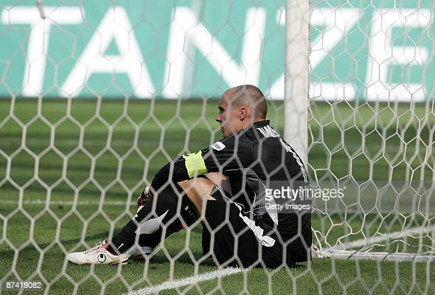 Robert Enke goalkeeper of Hannover looks dejected after the Bundesliga match between Hannover 96 and VfL Wolfsburg at the AWD Arena on May 16 2009 in...