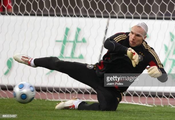 Robert Enke jumps for the ball during the Germany training session at the Shanghai Stadium on May 27 2009 in Shanghai China