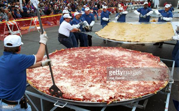 Robert Estrada and others maneuver a tortilla into place October 8 2000 as they make an attempt to set the Guinness World Record for the world's...