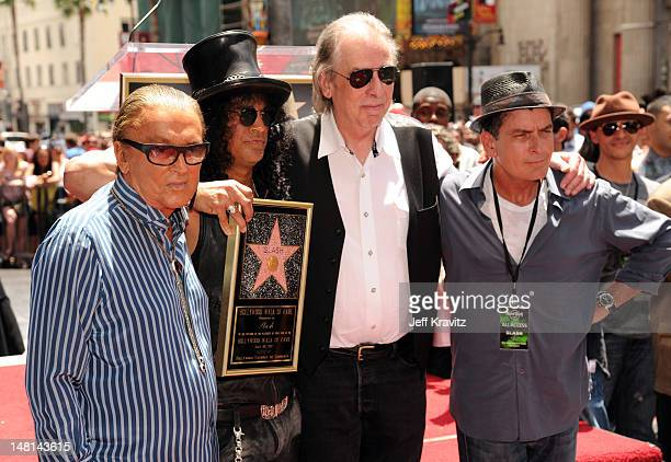 Robert Evans Slash Jim Ladd and Charlie Sheen pose as Slash is honored with a star on the Hollywood Walk of Fame on July 10 2012 in Hollywood...