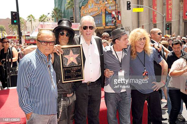 Robert Evans Slash Jim Ladd Charlie Sheen and Steven Adler pose as Slash is honored with a star on the Hollywood Walk of Fame on July 10 2012 in...