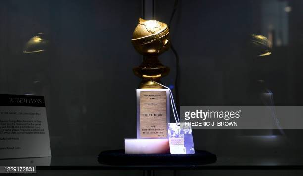 Robert Evans's 1974 Golden Globe Award from the movie Chinatown is displayed during an auction preview of Property from the Estate of Robert Evans at...