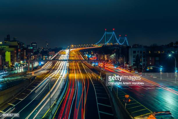 robert f. kennedy bridge at night - queens new york city stock pictures, royalty-free photos & images