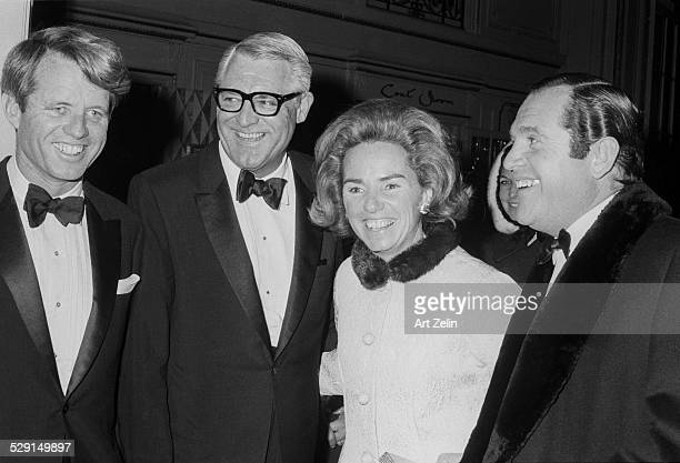 Robert F. Kennedy, Cary Grant, Ethel Kennedy, Alan King at a formal black tie event; circa 1970; New York.