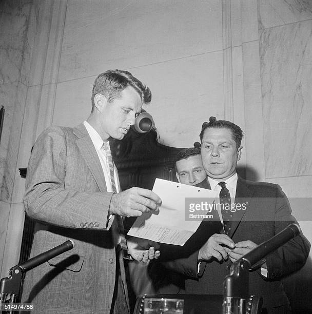 Robert F. Kennedy , chief counsel for the Senate Labor Rackets Committee, meets with James R. Hoffa in a brief conference prior to the Teamster...