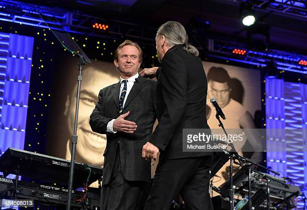 Robert F Kennedy Jr and honoree John Paul DeJoria speak onstage during Muhammad Ali's Celebrity Fight Night XX held at the JW Marriott Desert Ridge...