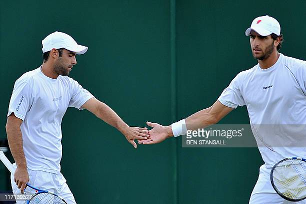 Robert Farah and Juan Sebastian Cabal of Colombia play against India's Rohan Bopanna and Pakistan's AisamUlHaq Qureshi in a Men's Doubles match at...