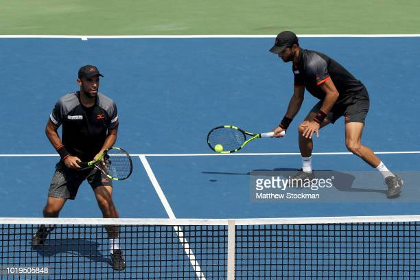 Robert Farah and Juan Sebastian Cabal of Colombia play Bruno Soares of Brazil and Jamie Murray of Great Britain during the men's doubles final of the...