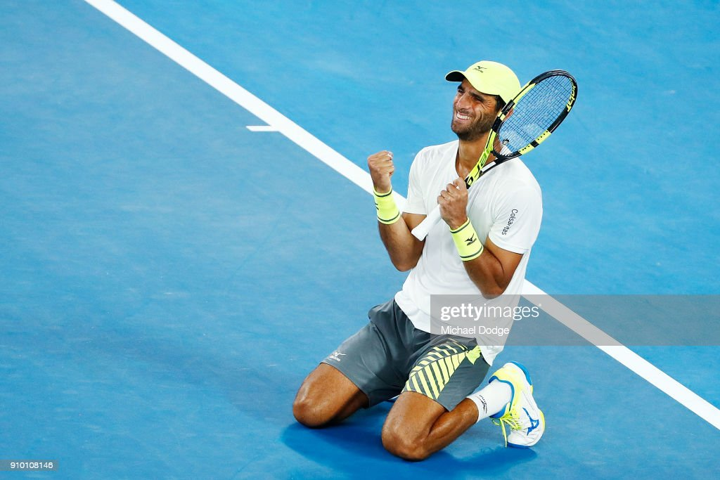 Robert Farah of Colombia, partnering Juan Sebastian Cabal of Colombia, celebrates their win in their semi-final match against Mike Bryan and Bob Bryan of the USA on day 11 of the 2018 Australian Open at Melbourne Park on January 25, 2018 in Melbourne, Australia.