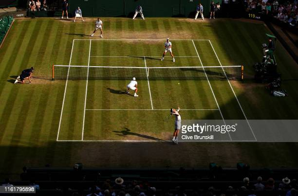 Robert Farah of Colombia, playing partner of Juan Sebastian Cabal of Colombia serves in their Men's Doubles final against Nicolas Mahut of France and...