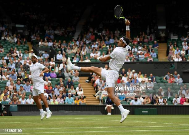 Robert Farah of Colombia, playing partner of Juan Sebastian Cabal of Colombia plays a shot in their Men's Doubles final against Nicolas Mahut of...