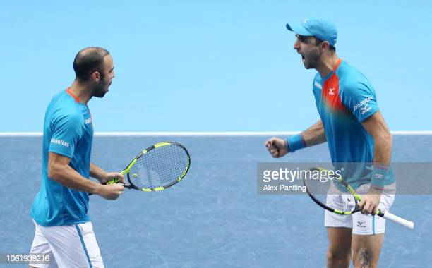 Robert Farah of Columbia and Juan Sebastian Cabal of Columbia celebrates during their round robin match against Michael Venus of New Zealand and...