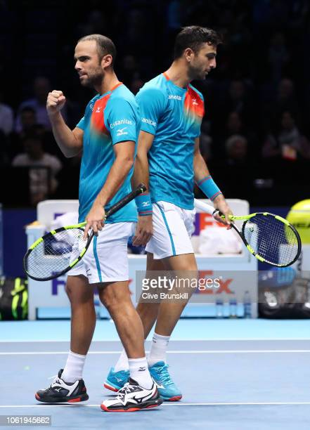 Robert Farah of Columbia and Juan Sebastian Cabal of Columbia celebrate match point after they win their round robin match against Michael Venus of...