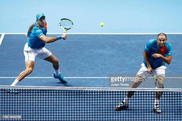 Robert Farah of Columbia and Juan Sebastian Cabal of Columbia return the ball during their round robin match against Michael Venus of New Zealand and...