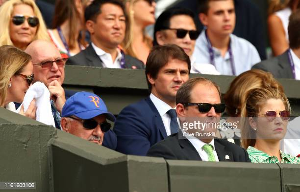 Robert Federer, father of Roger Federer, Tony Godsick agent of Roger Federer and Mirka Federer wife of Roger Federer look on prior to the Men's...