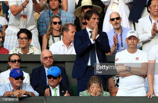 Robert Federer, father of Roger Federer, Tony Godsick agent of Roger Federer and Mirka Federer wife of Roger Federer react during the Men's Singles...