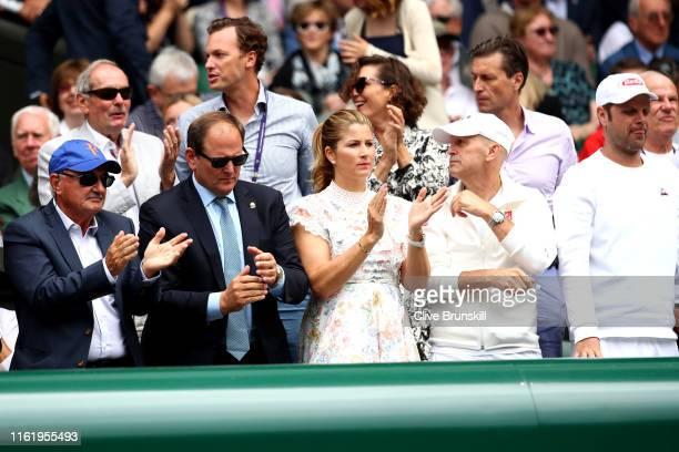 Robert Federer, father of Roger Federer, Tony Godsick agent of Roger Federer and Mirka Federer wife of Roger Federer show their support in the Men's...