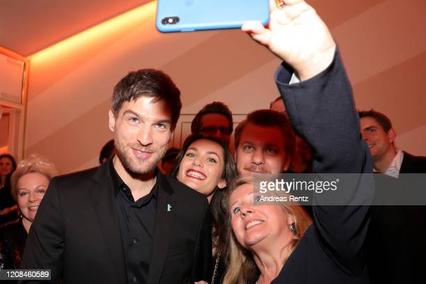 Robert Finster Ella Rumpf showrunner Marvin Kren and guest pose at the Netflix premiere of Freud during the 70th Berlinale International Film...