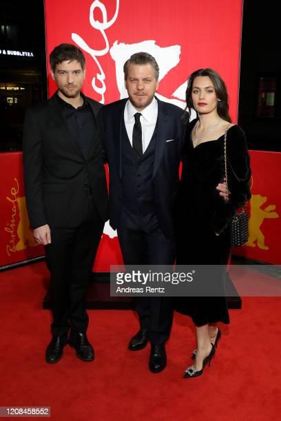 Robert Finster showrunner Marvin Kren and Ella Rumpf attend the Netflix premiere of Freud during the 70th Berlinale International Film Festival...