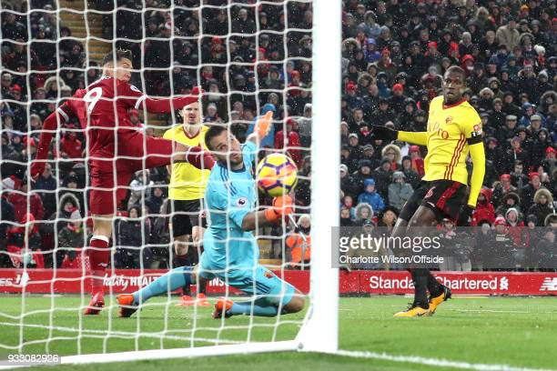 Robert Firmino of Liverpool scores their 3rd goal during the Premier League match between Liverpool and Watford at Anfield on March 17 2018 in...