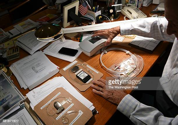 Robert Fischell shows off a few of his medical devices that he has invented Fischell holds over 200 patents and has been recognized as the national...