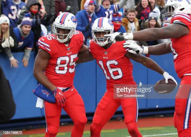 Robert Foster of the Buffalo Bills celebrates with Charles Clay after running for a touchdown in the fourth quarter during NFL game action against...