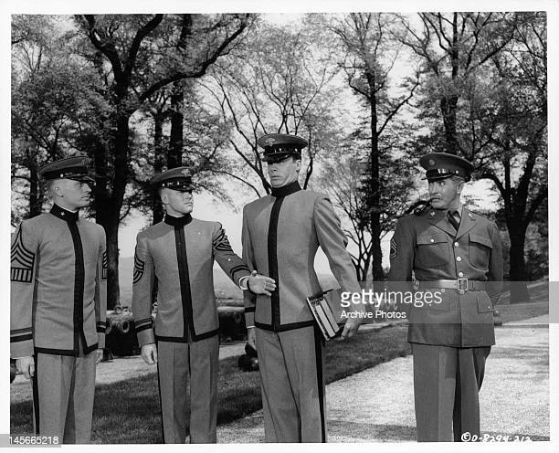 Robert Francis takes some hazing as a plebe while old sergeant Tyrone Power looks on in a scene from the film 'The Long Gray Line' 1955