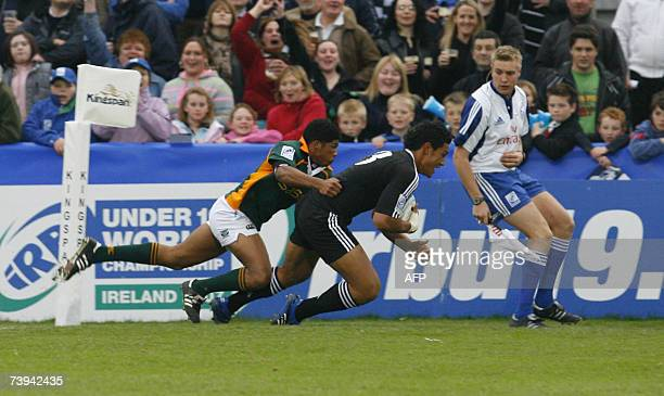 Robert Fruean of New Zealand runs in for a try as Bernado Botha of South Africa tries to tackle him 21 April 2007, during the IRB Under 19 World...