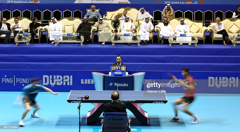 Robert Gardos of Austria and Tiago Apolonia of Portugal are watched by locals as they battle in the semi final of the 2015 IFFT World Team Cup at the Al Nasr Stadium on January 10, 2015 in Dubai, United Arab Emirates.