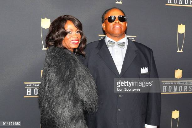 Robert Garrett the 2017 Don Shula NFL High School Coach of the Year and his wife pose for photographs on the Red Carpet at NFL Honors during Super...