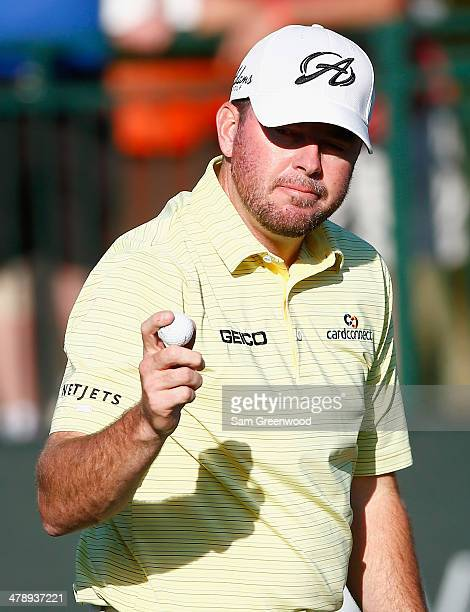 Robert Garrigus acknowledges the gallery on the 18th green during the third round of the Valspar Championship at Innisbrook Resort and Golf Club on...