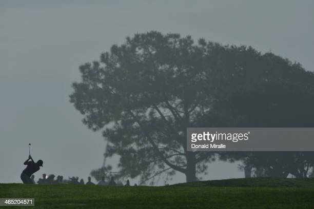 Robert Garrigus hits a shot on the second fareway during the final round of the Farmers Insurance Open on Torrey Pines South on January 26, 2014 in...