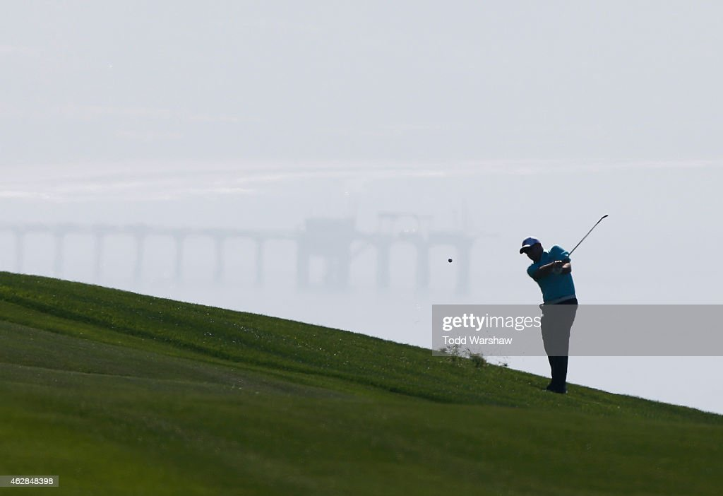 Robert Garrigus plays a shot from the fairway on the fourth hole of the south course during the first round of the Farmers Insurance Open at Torrey Pines Golf Course on February 5, 2015 in La Jolla, California.