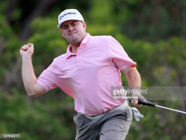 Robert Garrigus reacts to an eagle putt on the 18th hole during the third round of the Hyundai Tournament of Champions at the Plantation course on...