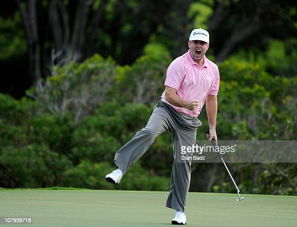 Robert Garrigus reacts to his eagle putt on the 18th green during the third round of the Hyundai Tournament of Champions at Plantation Course at...