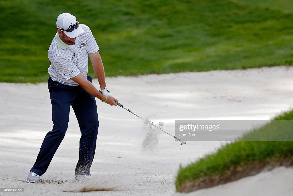 Robert Garrigus takes a shot in a bunker on the ninth hole during the second round of the John Deere Classic held at TPC Deere Run on July 10, 2015 in Silvis, Illinois.
