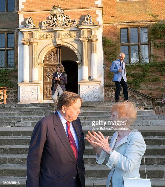 Robert GascoyneCecil 7th Marquess of Salisbury with English sculptor Angela Conner at Lord Salisbury's home Hatfield House Hertfordshire 15th June...