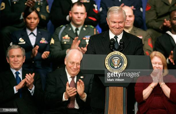 Robert Gates recieves applause by US President George W Bush Vice President Dick Cheney and Becky Gates after he was sworn in as Defense Secretary...