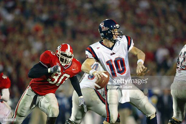 Robert Geathers of Georgia applies pressure to Quarterback Eli Manning of Mississippi during the SEC game between on November 9, 2002 at Sanford...