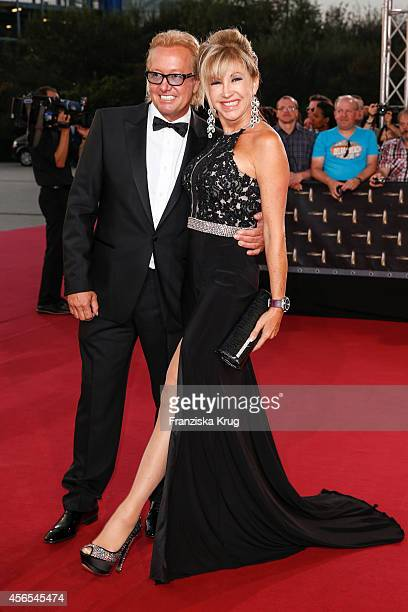 Robert Geiss and Carmen Geiss attend the red carpet of the Deutscher Fernsehpreis 2014 on October 02 2014 in Cologne Germany
