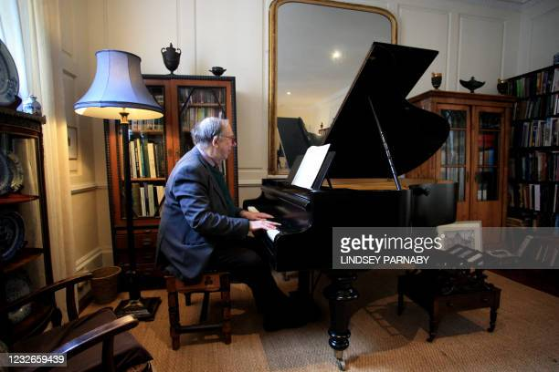 Robert Geoffrey William Anderson, retired British Museum curator and historian of chemistry, plays on a grand piano once owned by his...