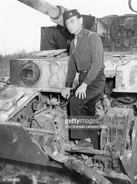 Robert George Bill Candid photograph [at Aberdeen Proving Ground] Standing on a destroyed German tank c 35 years of age 1947