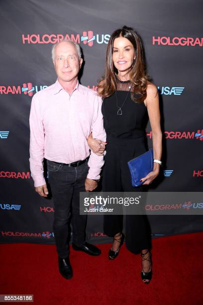 Robert Gerner and Janice Dickinson attend Hologram USA's Gala Preview at Hologram USA Theater on September 28 2017 in Los Angeles California