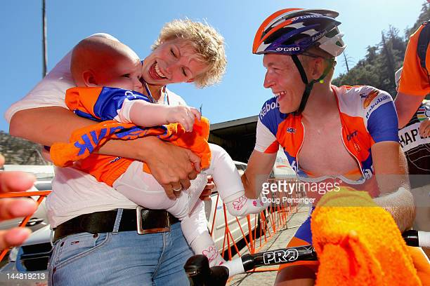 Robert Gesink of The Netherlands riding for Rabobank Cycling Team celebrates his victory in stage seven with Daisy and their daughter Anne as he also...