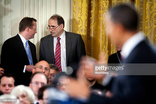 Robert Gibbs White House press secretary left and David Axelrod senior advisor to US President Barack Obama confer during a news conference with...
