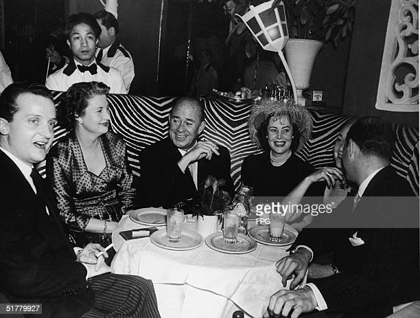Robert Glaenzer and companions sit in a dining booth at El Morocco New York New York early 1950s