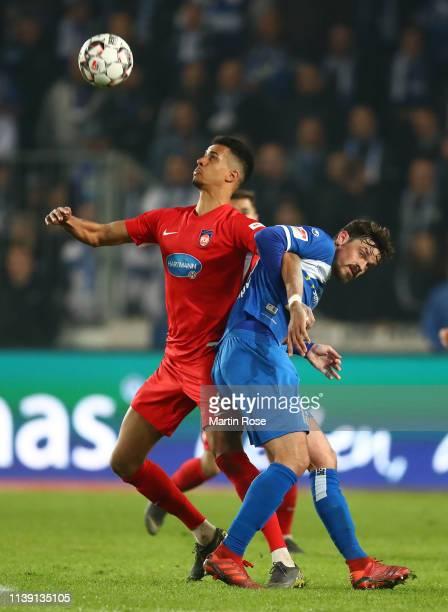 Robert Glatzel of 1FC Heidenheim battles for the ball with Dennis Erdmann of 1FC Magdeburg during the Second Bundesliga match between 1 FC Magdeburg...