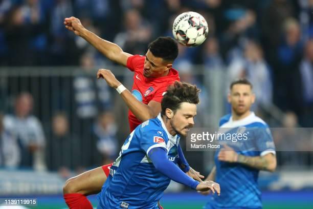 Robert Glatzel of 1FC Heidenheim rises over Dennis Erdmann of 1FC Magdeburg during the Second Bundesliga match between 1 FC Magdeburg and 1 FC...
