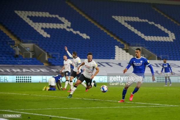 Robert Glatzel of Cardiff City FC and Matty Pearson of Luton Town during the Sky Bet Championship match between Cardiff City and Luton Town at...