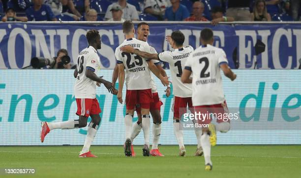 Robert Glatzel of Hamburg celebrates with team mates after scoring his teams first goal during the Second Bundesliga match between FC Schalke 04 and...